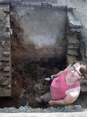 UT student Sam Upton stands by the bulkhead entrance to the cellar of the Coan Hall house.